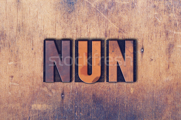 Nun Theme Letterpress Word on Wood Background Stock photo © enterlinedesign