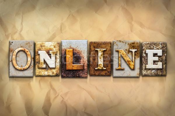On-line enferrujado metal tipo palavra escrito Foto stock © enterlinedesign