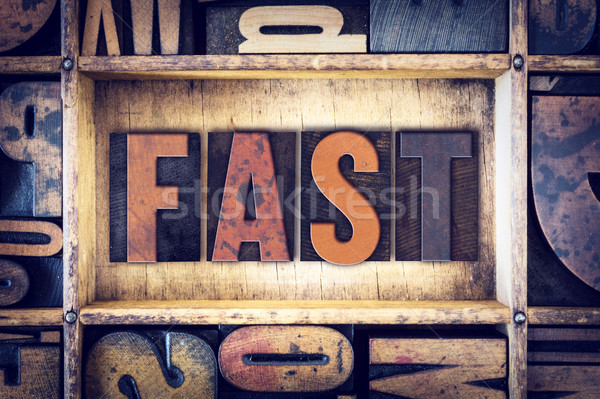 Fast Concept Letterpress Type Stock photo © enterlinedesign