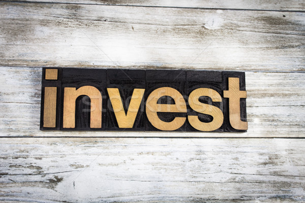 Invest Letterpress Word on Wooden Background Stock photo © enterlinedesign
