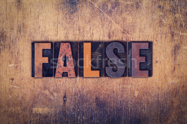 False Concept Wooden Letterpress Type Stock photo © enterlinedesign