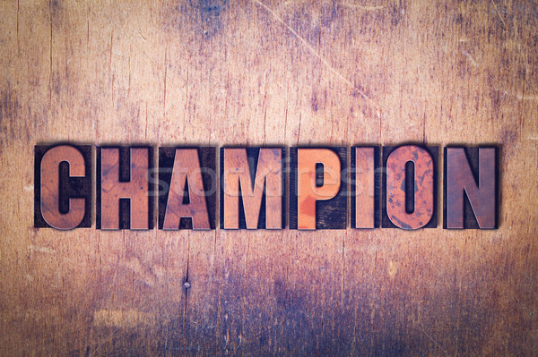 Champion Theme Letterpress Word on Wood Background Stock photo © enterlinedesign