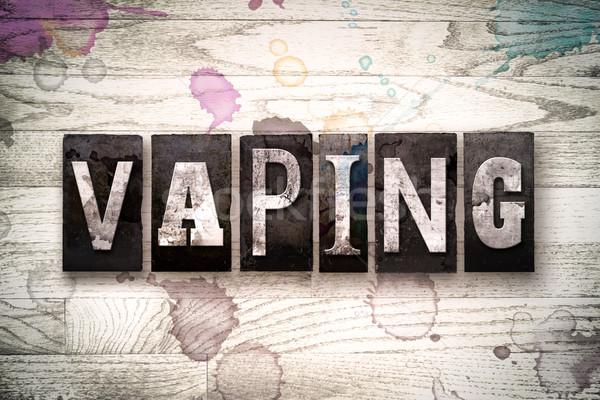 Vaping Concept Metal Letterpress Type Stock photo © enterlinedesign