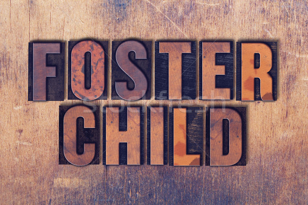 Foster Child Theme Letterpress Word on Wood Background Stock photo © enterlinedesign