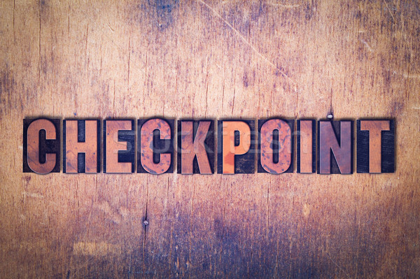 Checkpoint Theme Letterpress Word on Wood Background Stock photo © enterlinedesign