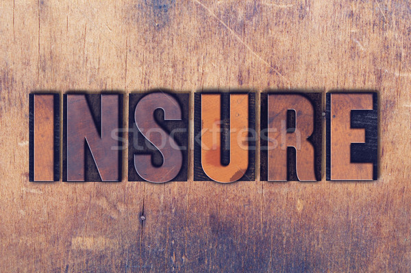 Insure Theme Letterpress Word on Wood Background Stock photo © enterlinedesign