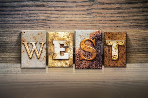 Oeste palabra escrito Rusty metal Foto stock © enterlinedesign