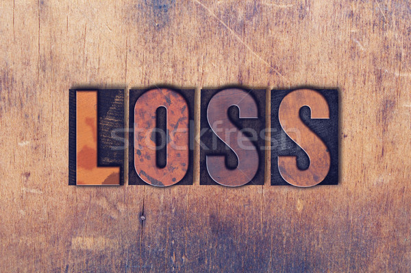 Loss Theme Letterpress Word on Wood Background Stock photo © enterlinedesign