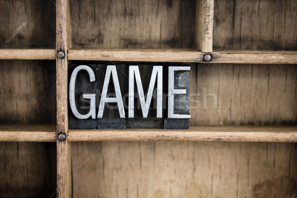 Game Concept Metal Letterpress Word in Drawer Stock photo © enterlinedesign