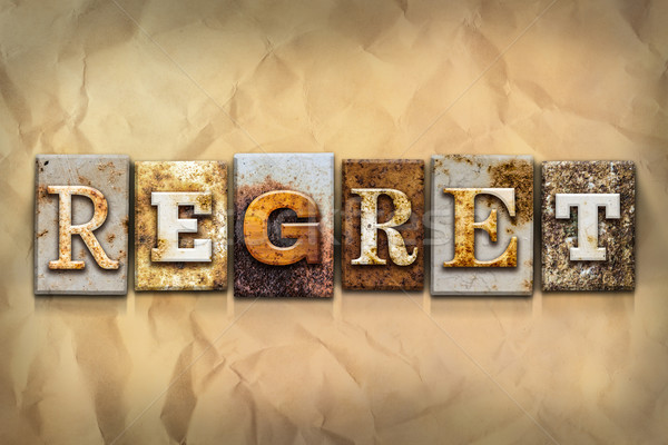Regret Concept Rusted Metal Type Stock photo © enterlinedesign