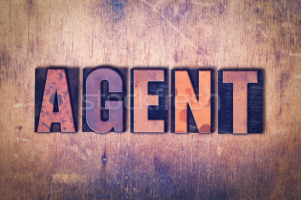 Agent Theme Letterpress Word on Wood Background Stock photo © enterlinedesign