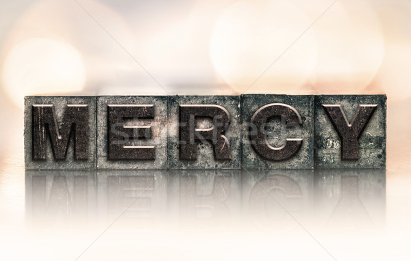 Mercy Concept Vintage Letterpress Type Stock photo © enterlinedesign