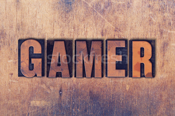 Gamer Theme Letterpress Word on Wood Background Stock photo © enterlinedesign