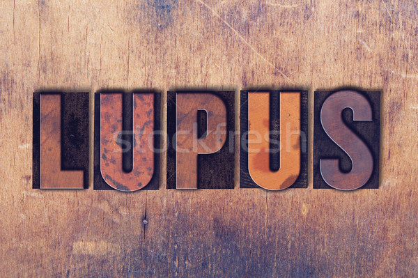 Lupus  Theme Letterpress Word on Wood Background Stock photo © enterlinedesign