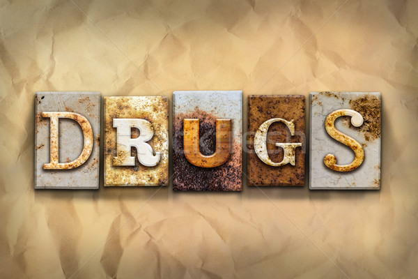 Drugs Concept Rusted Metal Type Stock photo © enterlinedesign