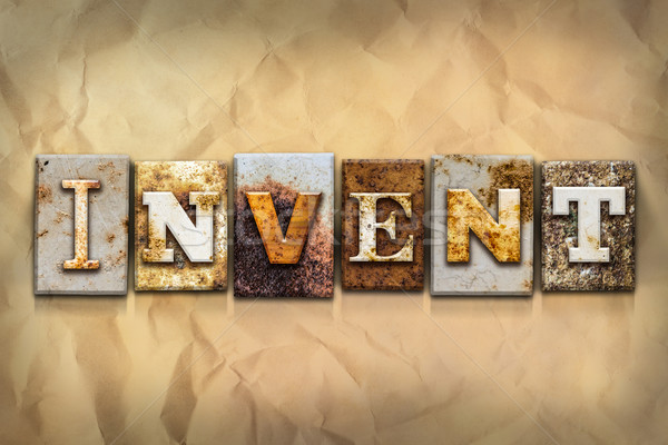 Invent Concept Rusted Metal Type Stock photo © enterlinedesign