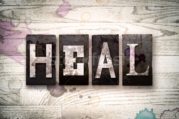 Heal Concept Metal Letterpress Type Stock photo © enterlinedesign