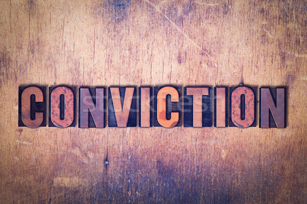 Stock photo: Conviction Theme Letterpress Word on Wood Background
