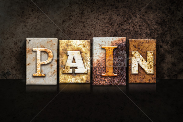 Pain Letterpress Concept on Dark Background Stock photo © enterlinedesign