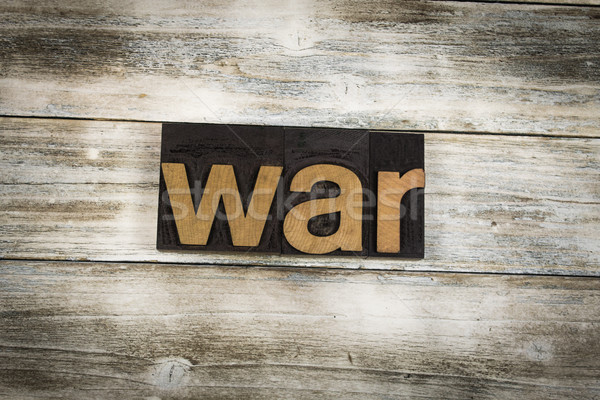 War Letterpress Word on Wooden Background Stock photo © enterlinedesign