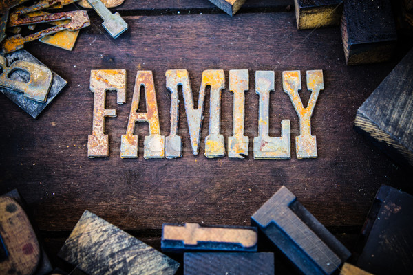 Family Concept Wood and Rusted Metal Letters Stock photo © enterlinedesign