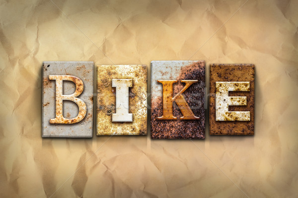 Bike Concept Rusted Metal Type Stock photo © enterlinedesign