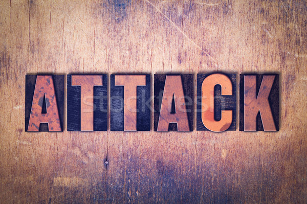Attack Theme Letterpress Word on Wood Background Stock photo © enterlinedesign