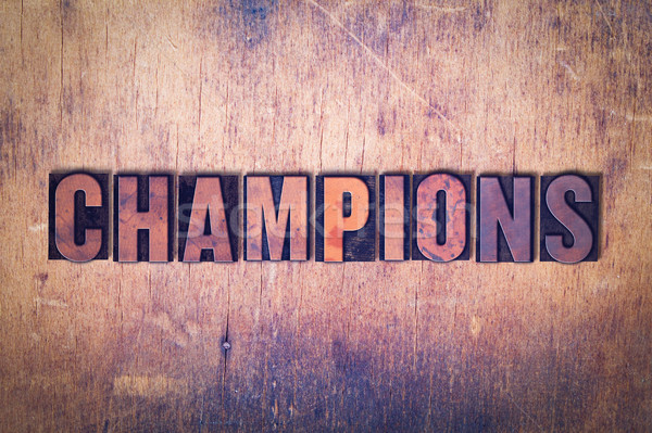 Champions Theme Letterpress Word on Wood Background Stock photo © enterlinedesign