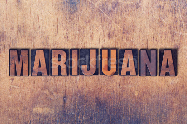 Marijuana Theme Letterpress Word on Wood Background Stock photo © enterlinedesign