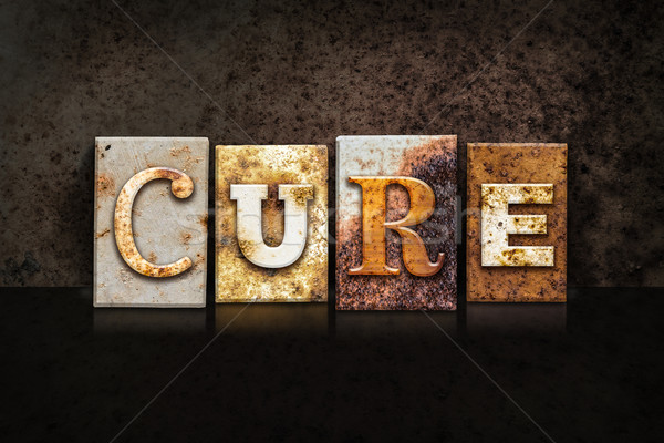 Cure Letterpress Theme on Black Stock photo © enterlinedesign