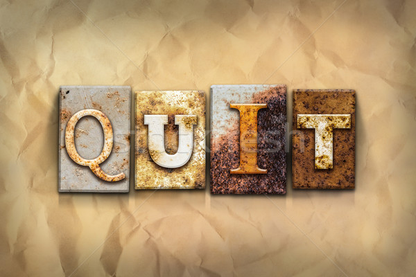 Quit Concept Rusted Metal Type Stock photo © enterlinedesign