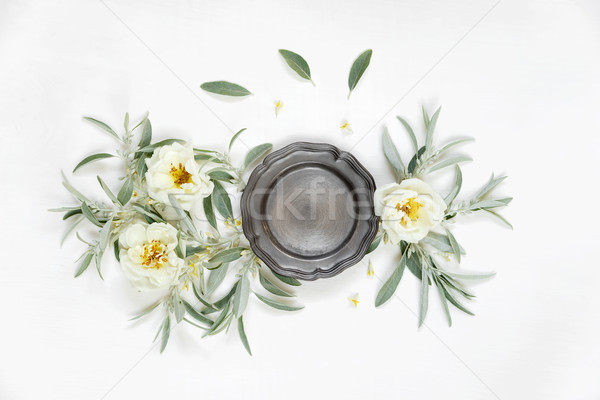 Stock photo: Decorative composition with metal  plate and rose flowers