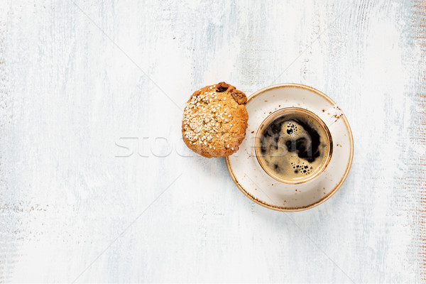 Stock photo: Black coffee and oatmeal cookie