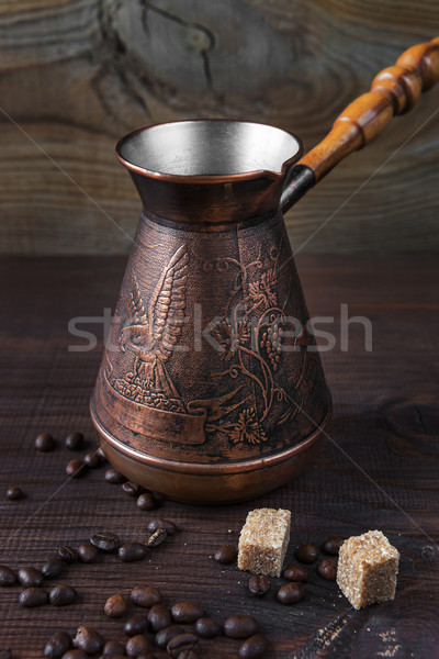 Ancient coffee maker on a dark wooden background Stock photo © Epitavi