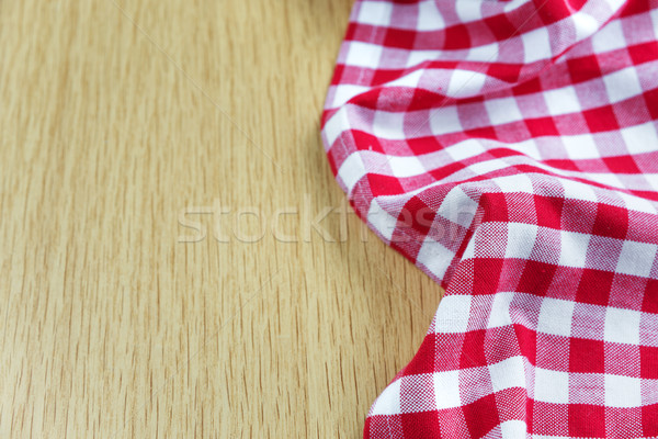 Checked tablecloth is on the wooden table Stock photo © Epitavi