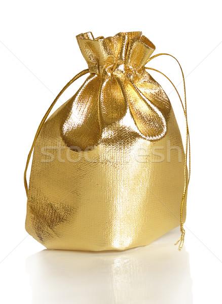 Altın hediye çanta yalıtılmış beyaz sunmak Stok fotoğraf © Epitavi