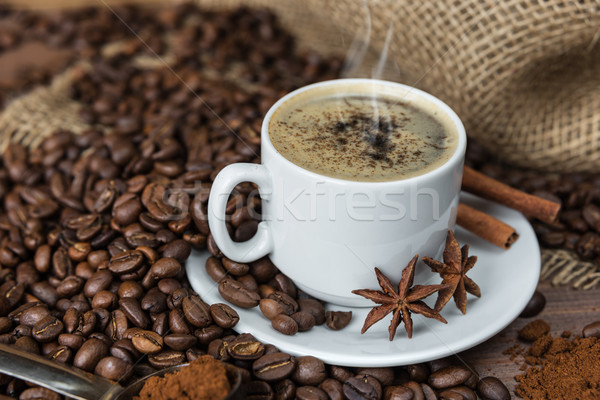 A cup of coffee and coffee beans Stock photo © Epitavi