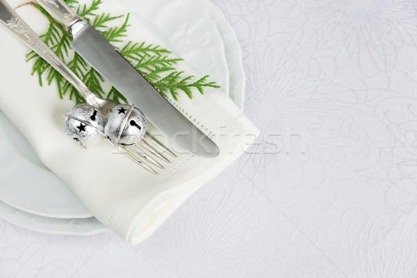 Christmas table with jingles and green twig Stock photo © Epitavi