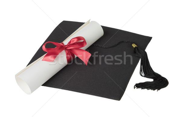 Graduate hat and paper scroll Stock photo © Epitavi