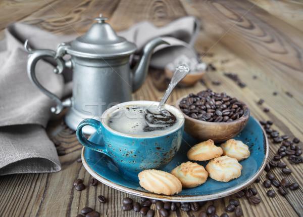 Kawy herbatniki niebieski kubek kawa czarna puli Zdjęcia stock © Epitavi