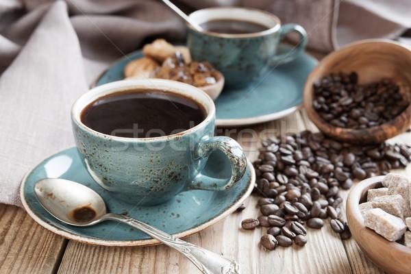 Café negro granos de café dos azul terrones de azúcar Foto stock © Epitavi