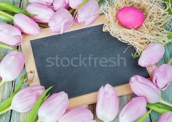 Easter composition with chalk board, tulips and egg Stock photo © Epitavi