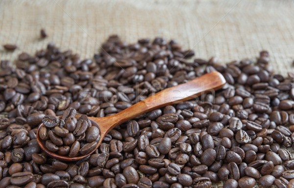Roasted coffee beans and wooden spoon Stock photo © Epitavi
