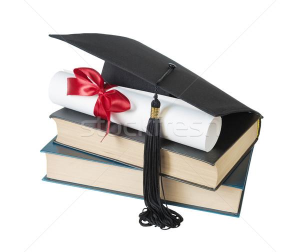 Graduate hat, books and scroll Stock photo © Epitavi