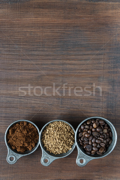 Different types of coffee on a wooden background Stock photo © Epitavi