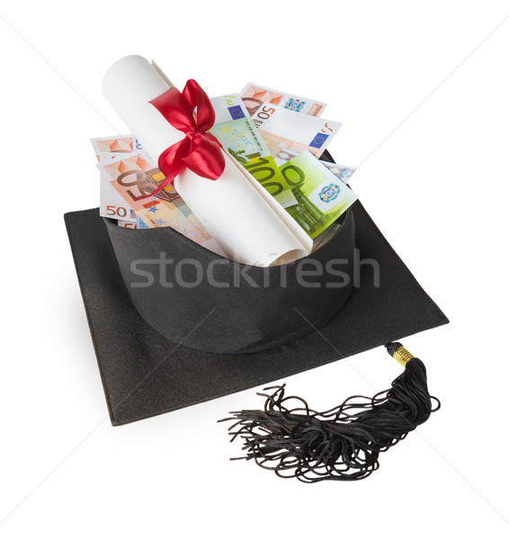 Graduate cap, banknotes and scroll Stock photo © Epitavi