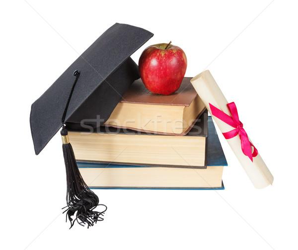 Graduate hat, books, apple and scroll Stock photo © Epitavi