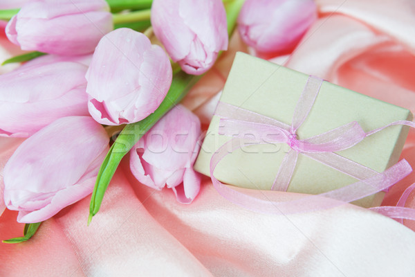 Flowers and gift box on a silk fabric Stock photo © Epitavi