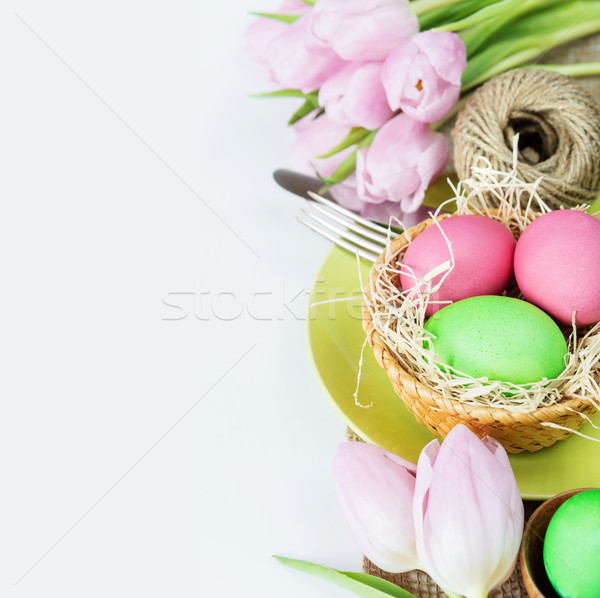 Basket with Easter eggs  and flowers Stock photo © Epitavi