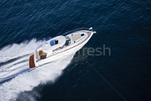 Fast motor boat sailing through an ocean Stock photo © epstock